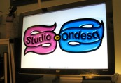 Decorative graphic of computer screen showing the Studio-Ondesq.com logo.